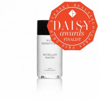 Daisy awards finalist logo. Vegan skin care from N.C.P Essentials, a transparent bottle with a black cap. Micellar Water.